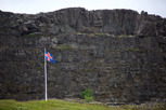 The icelandic flag with Lögberg as backdrop, Þingvellir