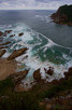 Rock formations and stormy waters around Knysna Heads