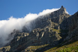 The Table Mountain with its table clothing approaching the cable car top station