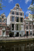 Old beautiful dutch house at the canals, Amsterdam