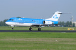 The dutch manufactured Fokker 70 in the colors of national airline of KLM Royal Dutch Airlines at Schiphol