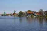 Old style village with windmills by the canal, Zaandam