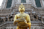 Buddha in front of the Temple of Dawn (Wat Arun), Bangkok