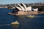 Sydney Opera House and Sydney Ferries as seen from Harbour Bridge, New South Wales