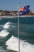 The Australian flag at a windy Bondi Beach, Sydney