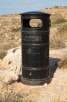 Black litter-bin at the country side, Malta