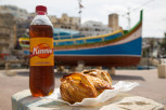 The local soft drink Kinnie together with some pastizzis and qassatats, St Julian