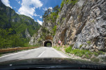 Mountainous roads with tunnels along the fjords
