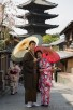 Japanese couple in front of Hokanji pagoda, Kyoto