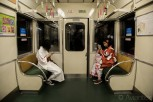 Japanese women in kimonos at local train, Kyoto