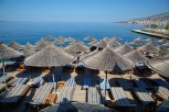 Straw parasols and sun beds at Santa Quaranta Resort, Sarandë