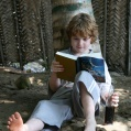 Ludvig reading Harry Potter in Tanzania