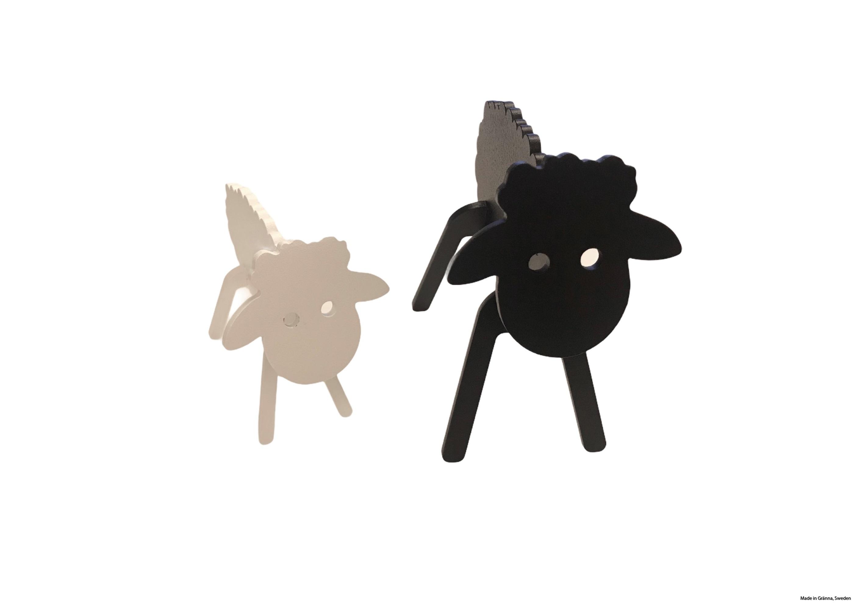 Svart får och vitt lamm