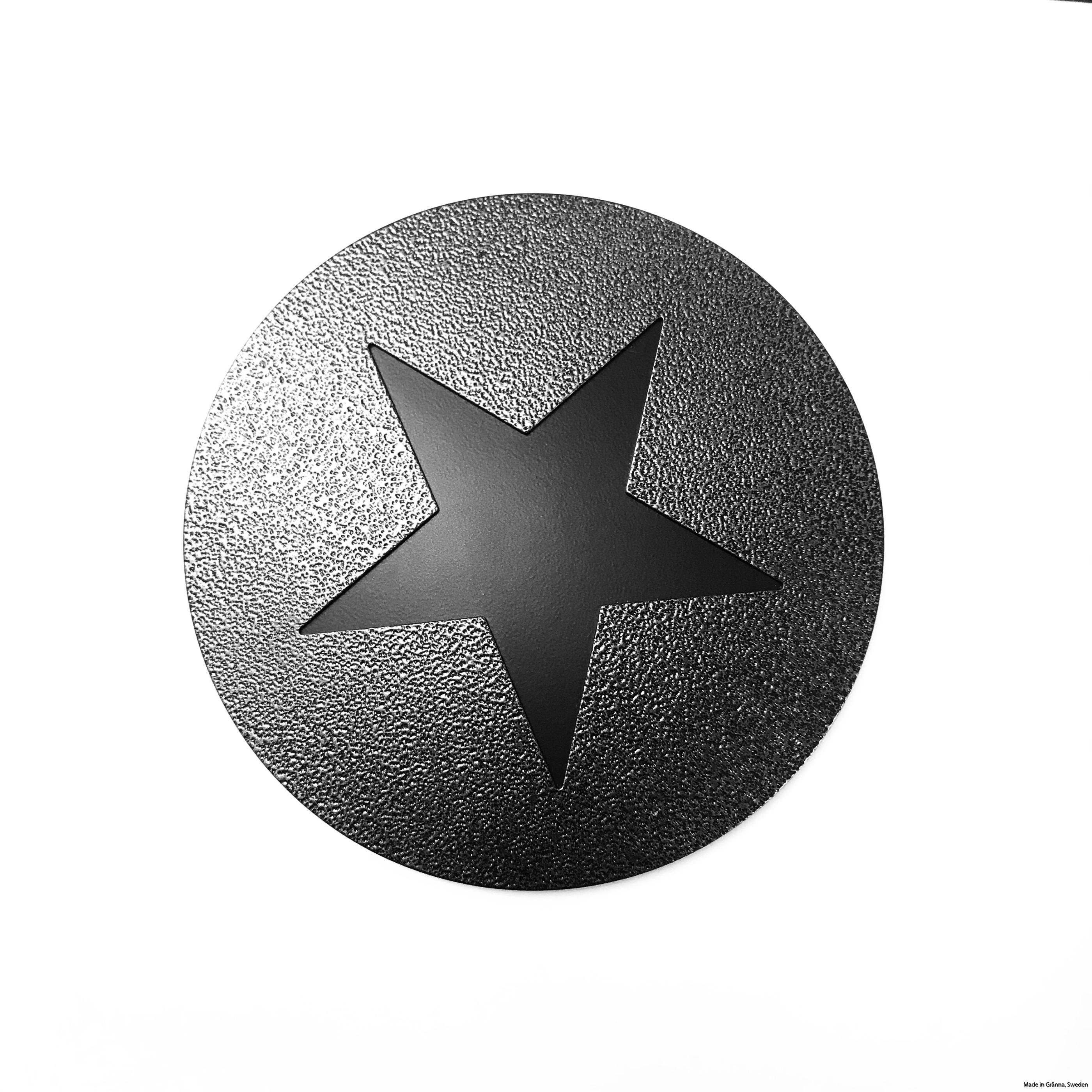 Runt underlägg med svart stjärna