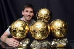 Messi med sin fyra guldbollar.