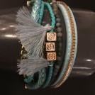 Armband i tyg och läder turkos