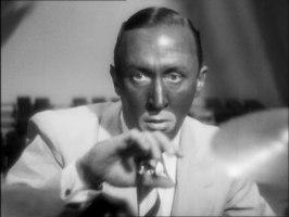 Percy Marmont som den sminkade skurken som håller på att bli avslöjad