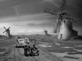 På väg ut bland väderkvarnar på den holländska landsbygden