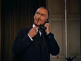 John Williams som kommisarie ur Slå nollan till polisen