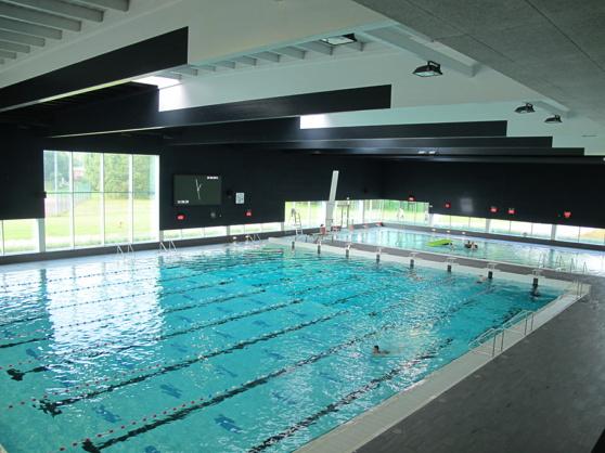 Anläggning i Mechelen, Belgien med höj- och sänkbara bottnar i både 25 meters bassängen och i undervisningsbassängen.
