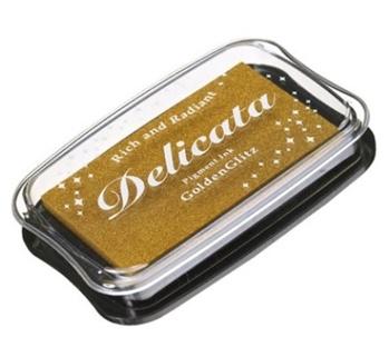 Delicata guldskimrande dyna