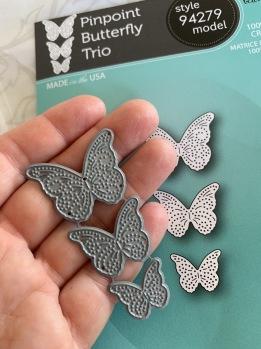 Set med tre små dies fjärilar. -